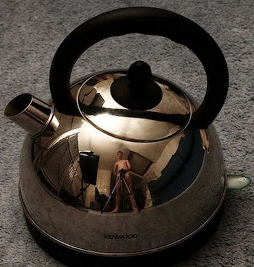 Naked man in tea kettle