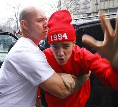 Justin Bieber held back by security