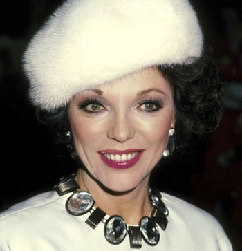 Joan Collins white fur