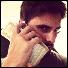 Scott Disick holding money