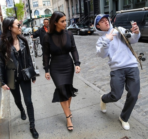 guy taking selfie with Kim Kardashian