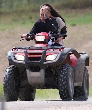 justin and selena on a four wheeler atv in ontario, canada