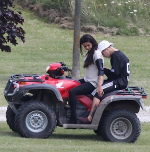 justin and selena on a four wheeler atv in ontario, canada